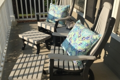 Dove Gray and Black Deacon's Swivel Gliders with stationary footrests on Porch